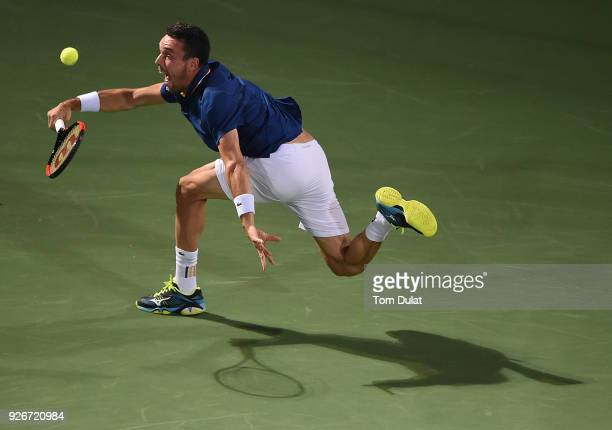 Roberto Bautista Agut of Spain plays a forehand during his final match against Lucas Pouille of France on day six of the ATP Dubai Duty Free Tennis...