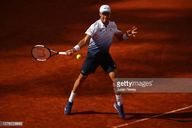 Roberto Bautista Agut of Spain plays a forehand during his Men's Singles third round match against Pablo Carreno Busta of Spain on day seven of the...