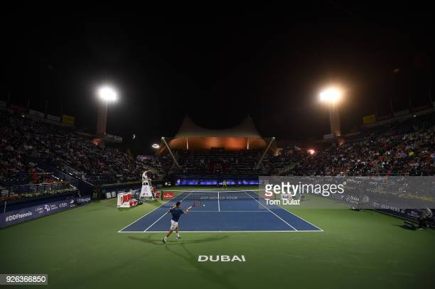 Roberto Bautista Agut of Spain plays a forehand during his semi final match against Malek Jaziri of Tunisia on day five of the ATP Dubai Duty Free...
