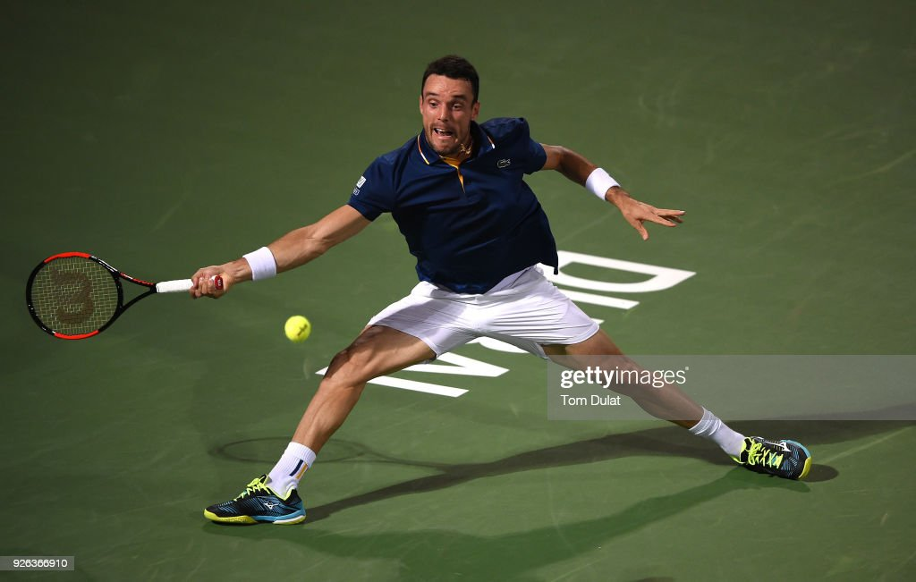 Roberto Bautista Agut of Spain plays a forehand during his semi final match against Malek Jaziri of Tunisia on day five of the ATP Dubai Duty Free Tennis Championships at the Dubai Duty Free Stadium on March 2, 2018 in Dubai, United Arab Emirates