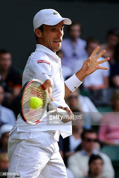 Roberto Bautista Agut of Spain plays a forehand return during his Gentlemen's Singles third round match against Andy Murray of Great Britain on day...