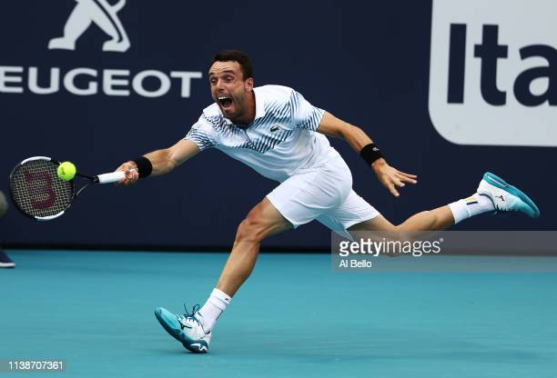 Roberto Bautista Agut of Spain plays a point against John Isner during day 10 of the Miami Open presented by Itau at Hard Rock Stadium on March 27...