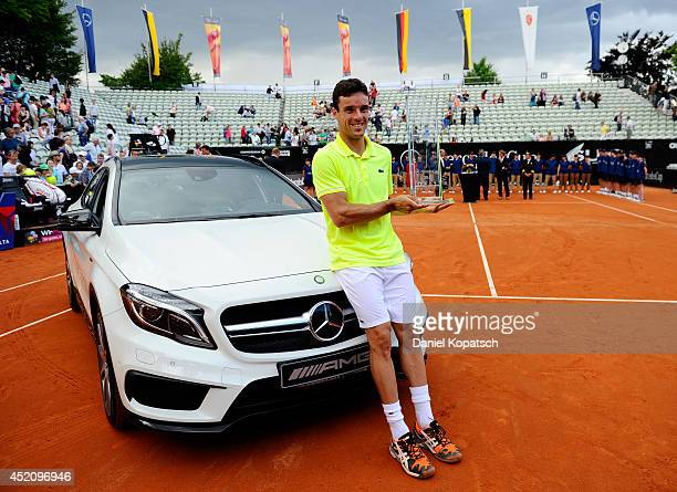 Roberto Bautista Agut of Spain poses after winning his final match against Lukas Rosol of Czech Republic on day seven of MercedesCup at TC Weissenhof...