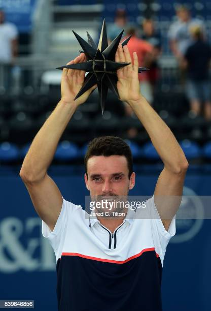 Roberto Bautista Agut of Spain poses with the trophy after defeating Damir Dzumhur of Bosnia and Herzegovina in the men's singles championship final...
