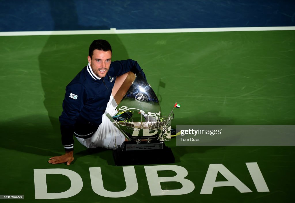 Roberto Bautista Agut of Spain poses with the trophy after winning the final match against Lucas Pouille of France on day six of the ATP Dubai Duty Free Tennis Championships at the Dubai Duty Free Stadium on March 3, 2018 in Dubai, United Arab Emirates