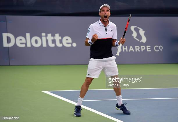 Roberto Bautista Agut of Spain reacts as he defeats Damir Dzumhur of Bosnia and Herzegovina after match point during the men's singles championship...