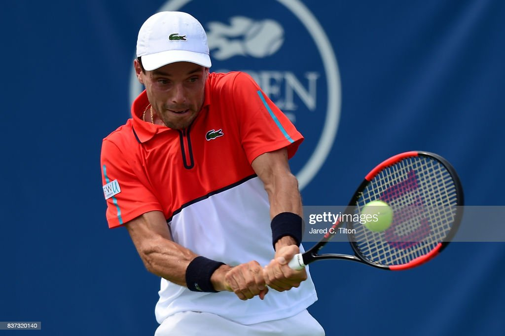 Roberto Bautista Agut of Spain returns a shot from Dusan Lajovic of Serbia during the fourth day of the Winston-Salem Open at Wake Forest University on August 22, 2017 in Winston-Salem, North Carolina.