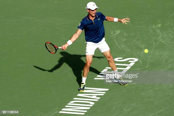 Roberto Bautista Agut of Spain returns a shot to Borna Coric of Croatia during the BNP Paribas Open at the Indian Wells Tennis Garden on March 12...