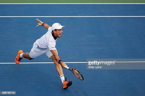 Roberto Bautista Agut of Spain returns a shot to Lucas Pouille of France during his third round Men's Singles match on Day Five of the 2016 US Open...
