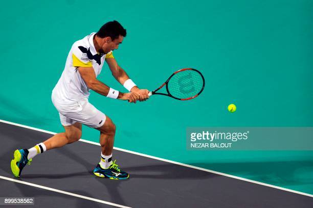 Roberto Bautista Agut of Spain returns the ball to Andy Murray of Great Britain during the Mubadala World Tennis Championship 2017 match in Abu Dhabi...