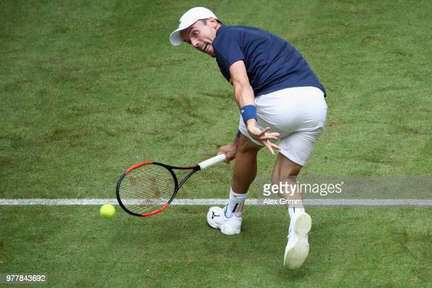 Roberto Bautista Agut of Spain returns the ball to Jan Lennard Struff of Germany during their first round match on day 1 of the Gerry Weber Open at...