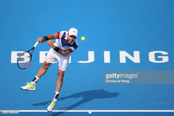 Roberto Bautista Agut of Spain serves against Grigor Dimitrov of Bulgaria during the Men's Quarterfinal match on day seven of the 2017 China Open at...