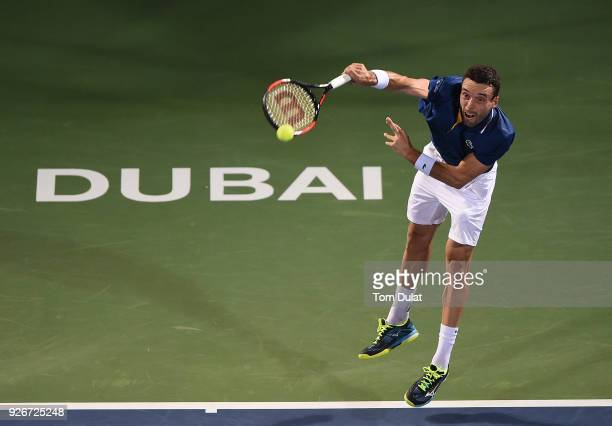 Roberto Bautista Agut of Spain serves during his final match against Lucas Pouille of France on day six of the ATP Dubai Duty Free Tennis...