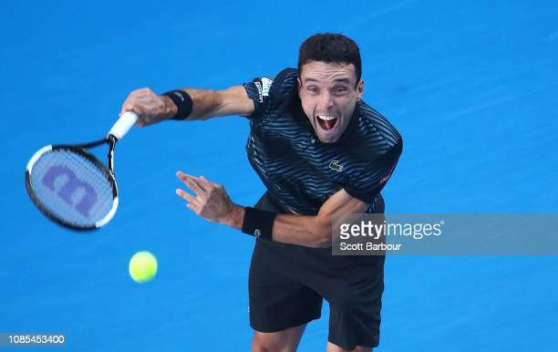 Roberto Bautista Agut of Spain serves in his fourth round match against Marin Cilic of Croatia during day seven of the 2019 Australian Open at...