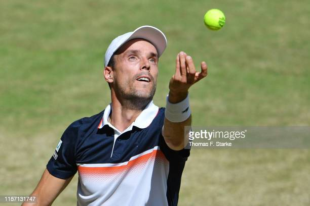 Roberto Bautista Agut of Spain serves in his match against Richard Gasquet of France during day 4 of the Noventi Open at Gerry Weber Stadium on June...