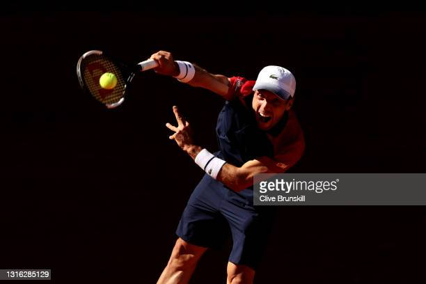 Roberto Bautista Agut of Spain serves in his mens singles match against Marco Cecchinato of Italy during day six of the Mutua Madrid Open at La Caja...