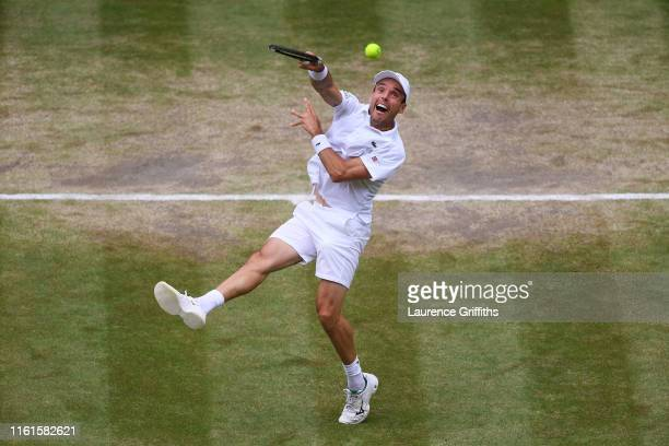 Roberto Bautista Agut of Spain serves in his Men's Singles semi-final match against Novak Djokovic of Serbia during Day eleven of The Championships -...