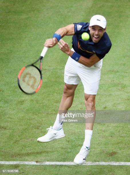 Roberto Bautista Agut of Spain serves the ball to Jan Lennard Struff of Germany during their first round match on day 1 of the Gerry Weber Open at...