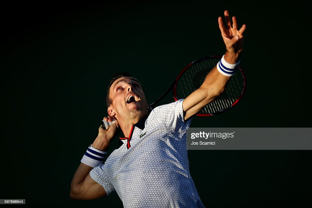 Roberto Bautista Agut of Spain serves to Guillermo Garcia-Lopez of Spain during his first round Men's Singles match on Day One of the 2016 US Open at the USTA Billie Jean King National Tennis Center on August 29, 2016 in the Flushing neighborhood of the Queens borough of New York City.