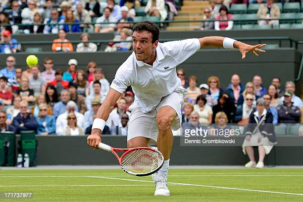 Roberto Bautista Agut of Spain volleys during his Gentlemen's Singles second round match against David Ferrer of Spain on day five of the Wimbledon...