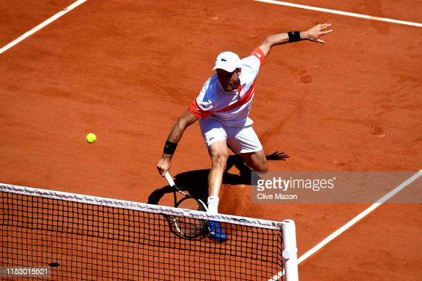 Roberto Bautista Agut of Spain volleys during his mens singles third round match against Fabio Fognini of Italy during Day seven of the 2019 French...