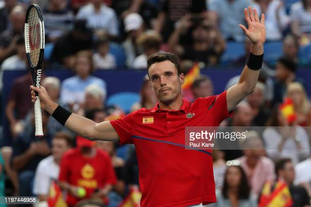 Roberto Bautista Agut of Team Spain celebrates winning his singles match against Aleksandre Metreveli of Team Georgia during day two of the 2020 ATP...