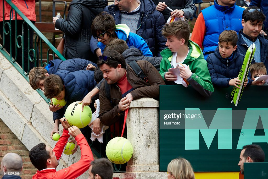 Roberto Bautista of Spain signs autographs prior to the doubles match between Feliciano Lopez and Marc Lopez of Spain against Tim Putz and Jan-Lennard Struff of Germany during day two of the Davis Cup World Group Quarter Finals match between Spain and Germany at Plaza de Toros de Valencia on April 7, 2018 in Valencia, Spain