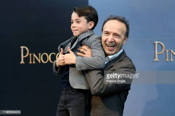 Roberto Benigni and Federico Lelapi attend the photocall of the movie Pinocchio on December 12 2019 in Rome Italy