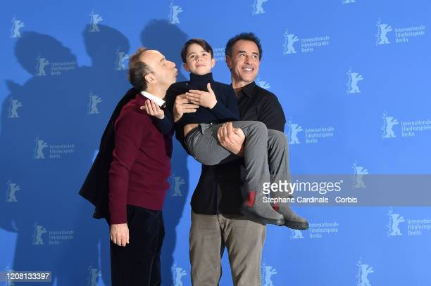 "Roberto Benigni, Federico Ielapi and Matteo Garrone pose at the ""Pinocchio"" photo call during the 70th Berlinale International Film Festival Berlin..."
