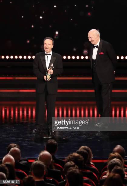 Roberto Benigni receives the Lifetime Achievement Award fron Giuliano Montaldo during the 61 David Di Donatello ceremony on March 27 2017 in Rome...