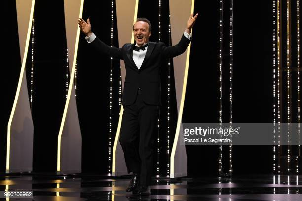 Roberto Benigni walks on stage during the Closing Ceremony at the 71st annual Cannes Film Festival at Palais des Festivals on May 19 2018 in Cannes...