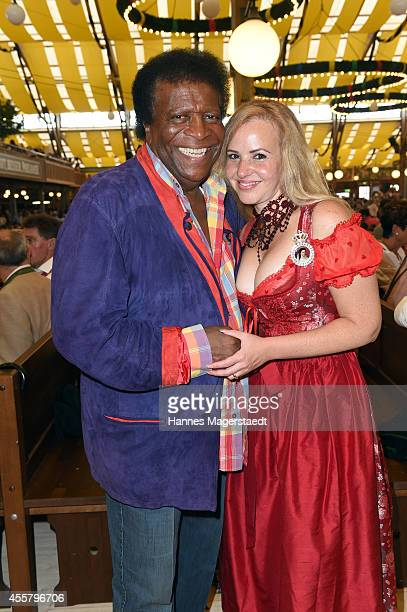 Roberto Blanco and his wife Luzandra attend the Winzerer Faehndl beer tent during the opening day of the 2014 Oktoberfest at Theresienwiese on...