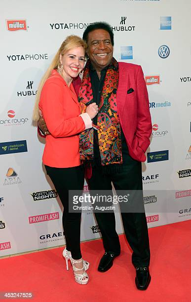 Roberto Blanco and Lauzandra Strassburg attend networking event 'Movie meets Media' at Hotel Atlantic on December 2 2013 in Hamburg Germany