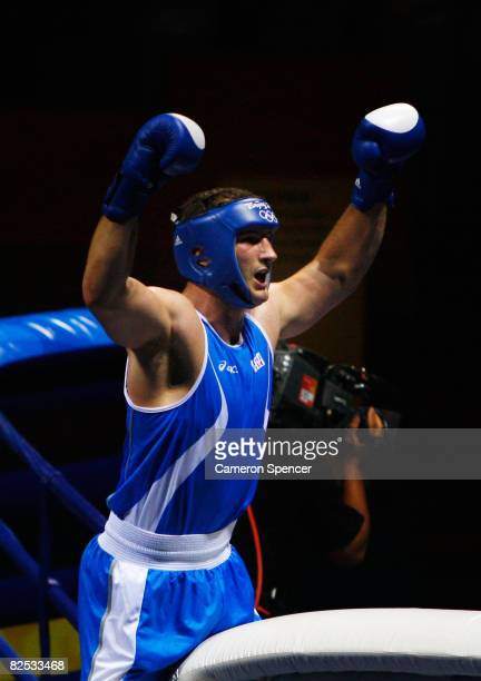 Roberto Cammarelle of Italy celebrates defeating Zhang Zhilei of China during the Men's Super Heavy Final Bout held at the Workers' Indoor Arena...