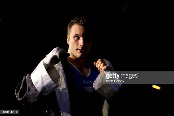 Roberto Cammarelle of Italy reacts after he was declared the winner against Magomedrasul Medzhidov of Azerbaijan during their Men's Super Heavy...