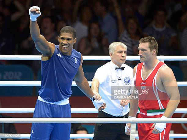 Roberto Cammarelle of Itay defends against Anthony Joshua of Great Britain during the gold medal SuperHeavyweight boxing final of the 2012 London...