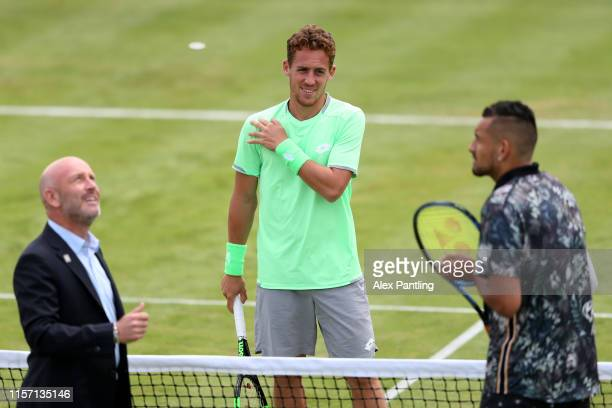 Roberto Carballes Baena of Spain and Nick Kyrgios of Australia share a joke during the coin toss prior to their First Round Singles Match during day...