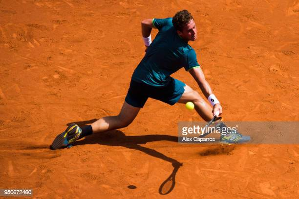 Roberto Carballes Baena of Spain plays a backhand against Andreas HaiderMaurer of Austria in their match during day three of the Barcelona Open Banc...