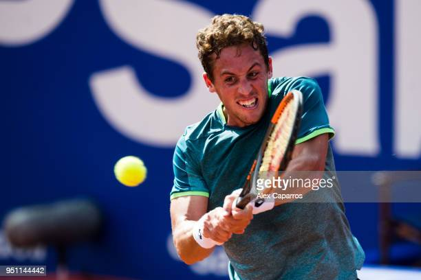 Roberto Carballes Baena of Spain plays a backhand against Rafael Nadal of Spain in their game during day three of the Barcelona Open Banc Sabadell on...