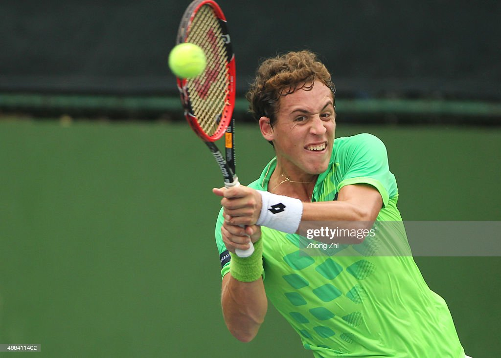 Roberto Carballes Baena of Spain returns a shot during his match against Hyeon Chung of Korea during the ATP Challenger Guangzhou Tour Day 5 at Guangzhou Development District International Tennis School on March 14, 2015 in Guangzhou, China.