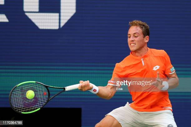 Roberto Carballes Baena of Spain returns a shot during his men's singles first round match against Novak Djokovic of Serbia during day one of the...