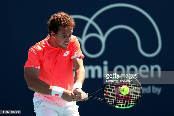Roberto Carballes Baena of Spain returns a shot to Borna Coric of Croatia during the Miami Open Presented by Itau at Hard Rock Stadium March 22 2019...