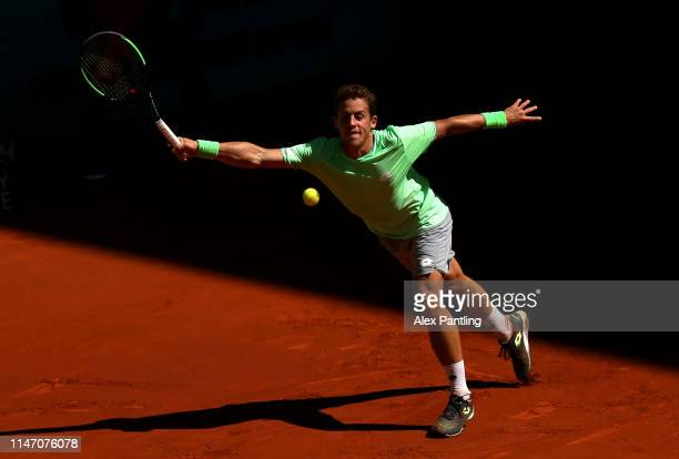 Roberto Carballes Baena of Spain returns in his match against Hubert Hurkacz of Poland during day two of the Mutua Madrid Open at La Caja Magica on...