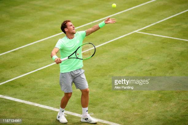 Roberto Carballes Baena of Spain serves during his First Round Singles Match against Nick Kyrgios of Australia during day Four of the FeverTree...