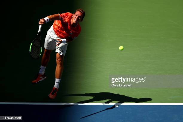 Roberto Carballes Baena of Spain serves during his men's singles first round match against Novak Djokovic of Serbia during day one of the 2019 US...