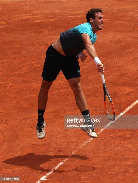 Roberto Carballes Baena of Spain serves during the mens singles first round match against Benoit Paire of France during day two of the 2018 French...