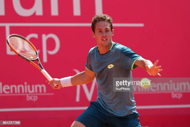Roberto Carballes Baena os Spain returns a ball to Cameron Norrie of Great Britan during the Millennium Estoril Open ATP 250 tennis tournament at the...