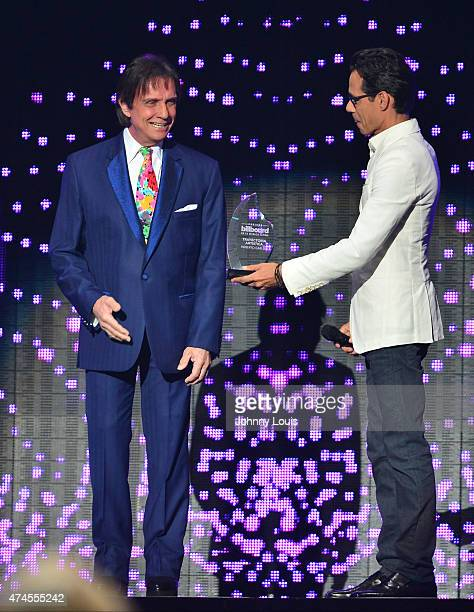 Roberto Carlos and Marc Anthony on stage during the 2015 Billboard Latin Music Awards presented by State Farm on Telemundo at Bank United Center on...