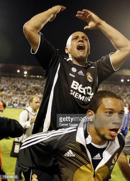 Roberto Carlos and Marcelo of Real Madrid celebrates after the La Liga match between Zaragoza and Real Madrid at the Romareda stadium on June 9 2007...