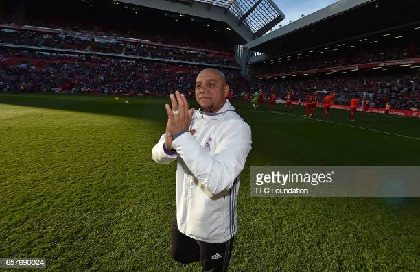 Roberto Carlos applauds at the end of the LFC Foundation Charity Match between Liverpool Legends and Real Madrid Legends at Anfield on March 25 in...